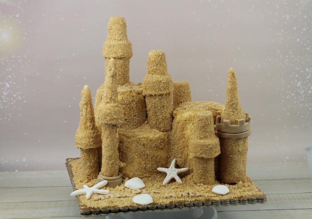 orchideli- tort urodzinowy dla dzieci, zamek z piasku na plaży, sand castle cake